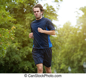 Man jogging outdoors in the forest