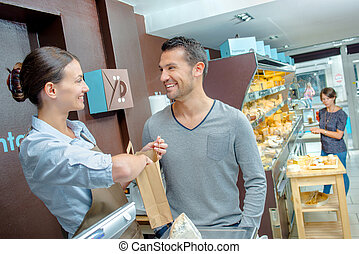 Man joking with shop assistant