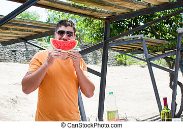 Man joking with watermelon