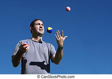 man, jonglera, klumpa ihop sig