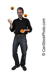 man juggles with oranges