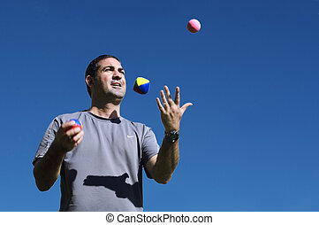Man Juggling Balls