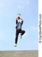 man jump and shout megaphone