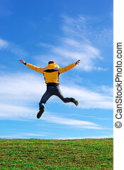 Man jump on the green meadow