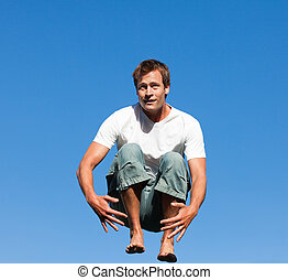 Man jumping in mid air - Young Man jumping in mid air
