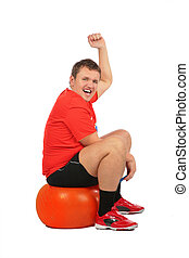 Man jumping on fitness sphere