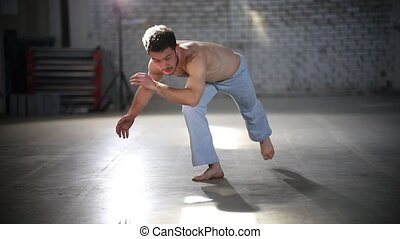 Man jumping on his hands and lifting feet up - Showing...