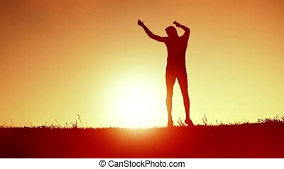 Man jumping on the background of sunset