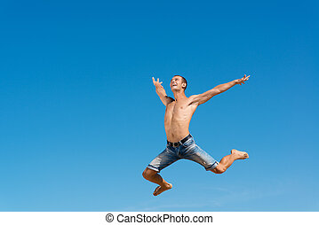 man jumping on the blue sky background