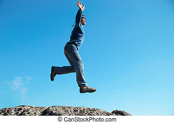 Man jumping on the rocks
