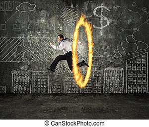 Man jumping through fire hoop with doodles wall