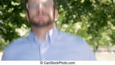 Man jumping up and down psyching himself up and preparing for something