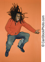 Man jumping with enthusiasm. - African-American mid-adult...