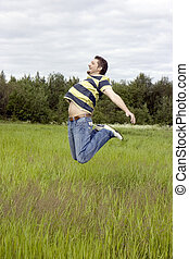man jumps on a grass