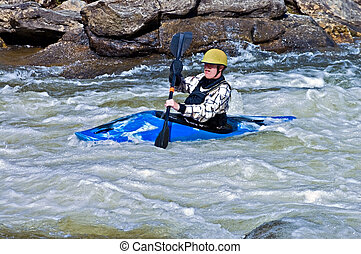 Man Kayaking Rapids