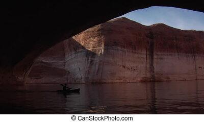 man kayaks red rock canyons on Lake Powell