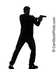 man killer policeman aiming gun standing silhouette - one...
