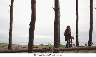 Man kindles coals in the brazier forest and sea hd woman goes out