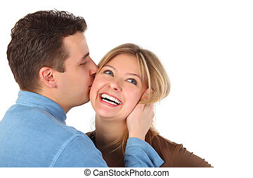 Man kisses young woman