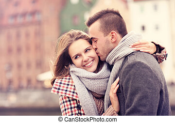 Man kissing a woman on a date
