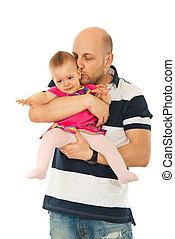 Man kissing crying baby