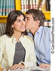 Man Kissing Girlfriend In College Library