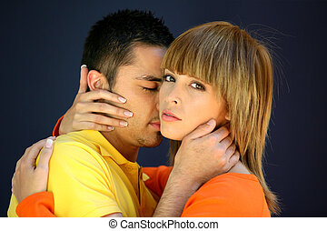 Man kissing girlfriend in the neck