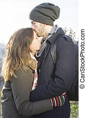 Man kissing his girlfriend in the forehead