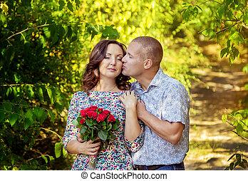 Man kissing his girlfriend on cheek