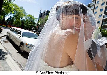 Man Kissing His Wife - Bridegroom kissing his happy wife
