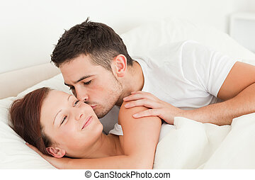 Man kissing his wife on the cheek