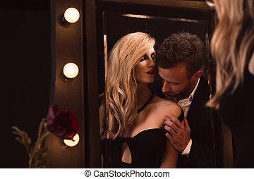 Man kissing his woman
