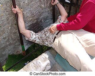 Man kissing the Blarney Stone - Blarney Castle near Cork,...
