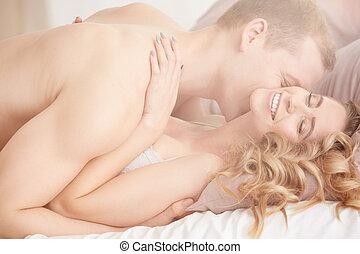 Man kissing woman's neck