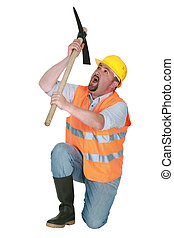 Man kneeling with pick-axe