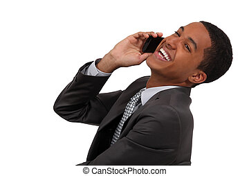 Man laughing during telephone call