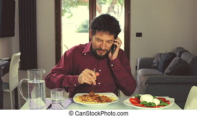 Man laughing on the phone at home
