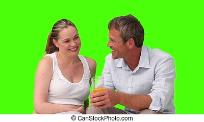 Man laughing with his pregnant wife