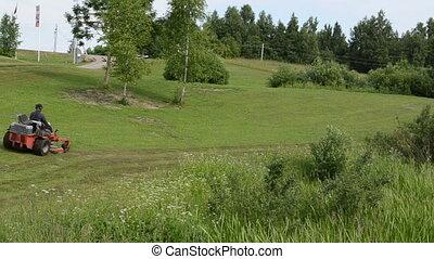 man lawn mower tractor - Man fast driving cut grass lawn...