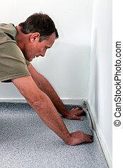 Man laying carpet