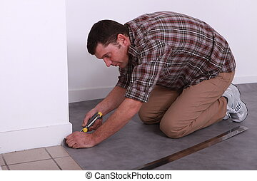 man laying lino