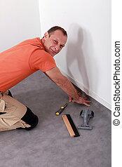 Man laying linoleum