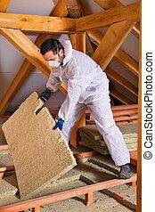 Man laying thermal insulation layer - Man installing thermal...