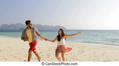 Man Leading Woman From Water, Couple Holding Hands Run On...