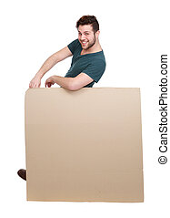 Man leaning on blank poster board