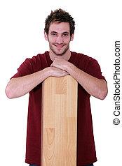 Man leaning on parquet flooring