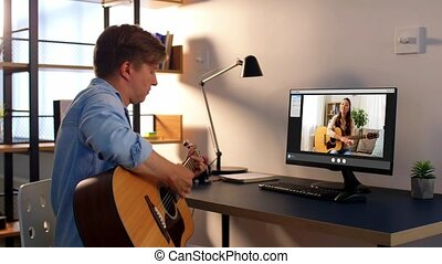 man learning to play guitar online at home - music, e-...