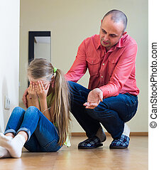 Man lecturing unpleased little girl - Serious father ...