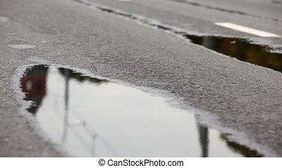Man legs run on wet asphalt one by one at XXX Moscow International Peace Marathon