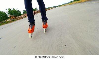 Man legs skating on concrete aerodrome surface. Inline...